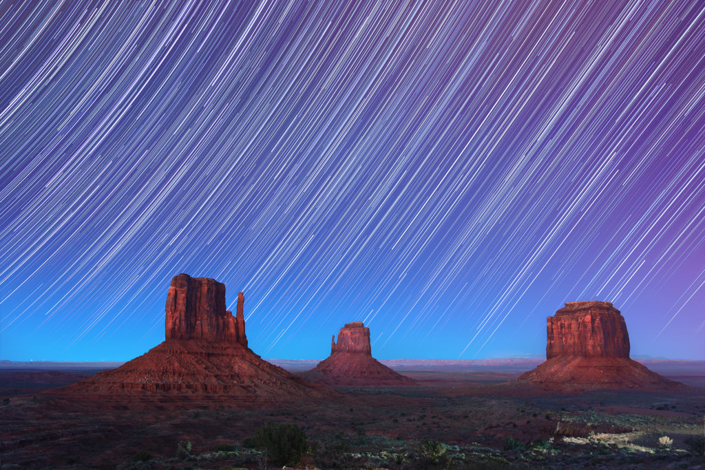Monument Valley at dusk with star trails. Utah, USA
